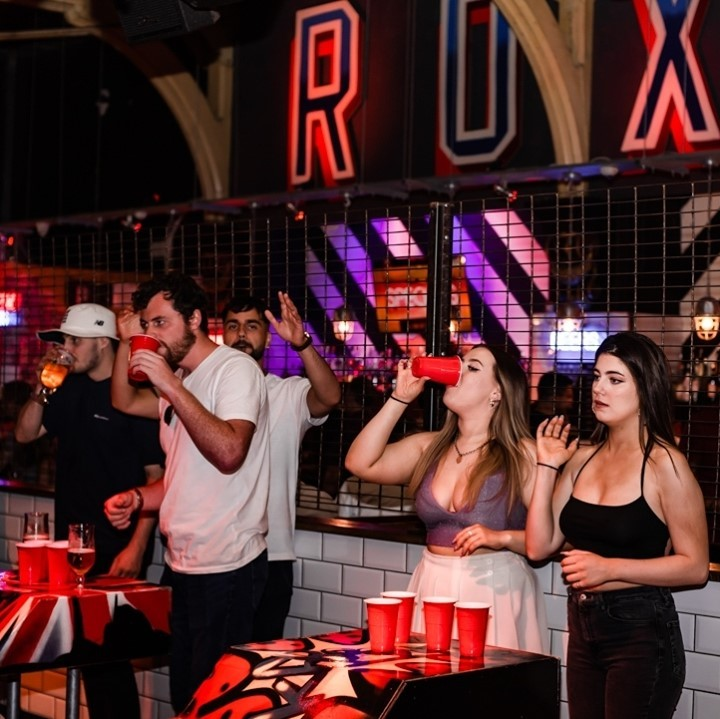 people playing beer pong at Roxys