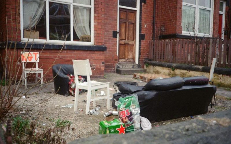 front of a house in Hyde Park with a sofa and rubbish outside